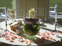 Centerpiece with submerged fruit and floating flowers.